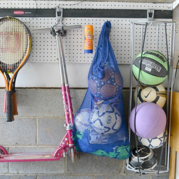 Banana Boat Sport Performance Lotion Sunscreen with Powerstay Technology on a peg board next to sports equipment