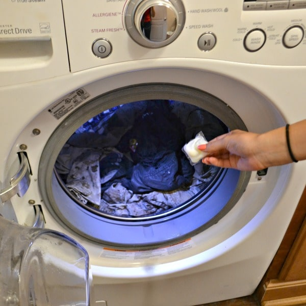 Tide Free & Gentle Detergent pouch being put into washer