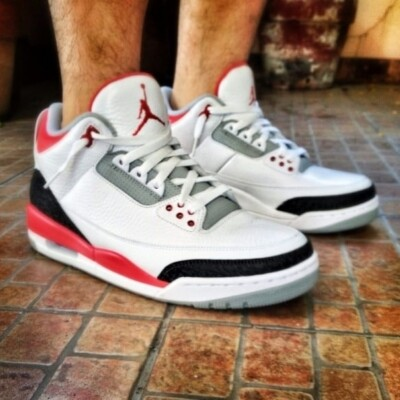 Red, black, and white Jordan sneakers