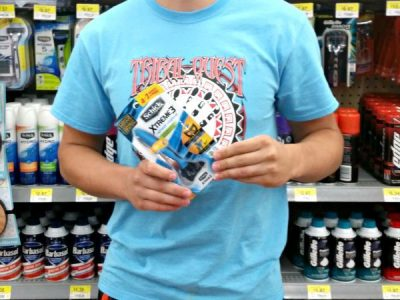 Young boy holding a razor in the grocery store