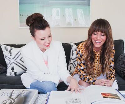2 women looking at interior design books