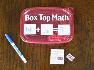 Plastic container that says box top math. 14 + 5 = 19