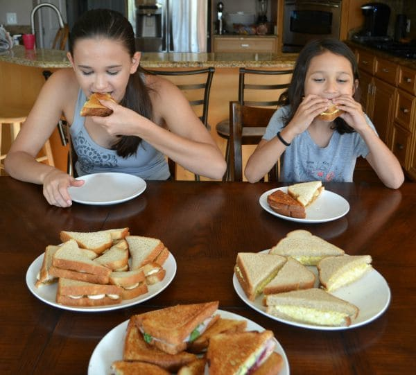 Girls Trying Sandwiches