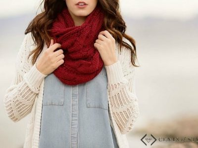 Woman in jean shirt, white cardigan, and red scarf