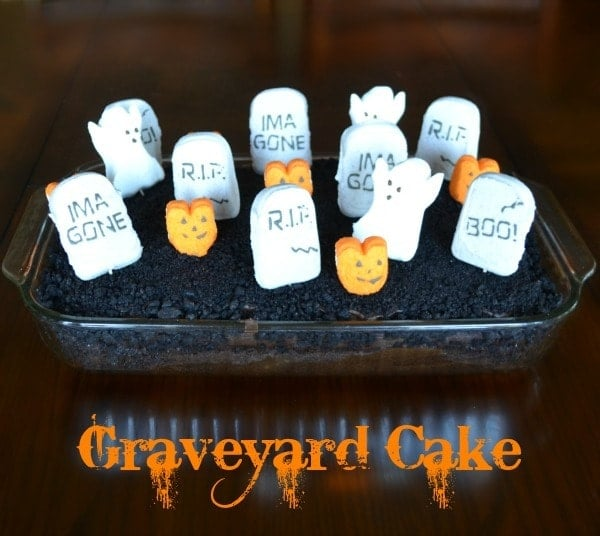 Graveyard Cake decorated with marshmallow grave markers and pumpkins