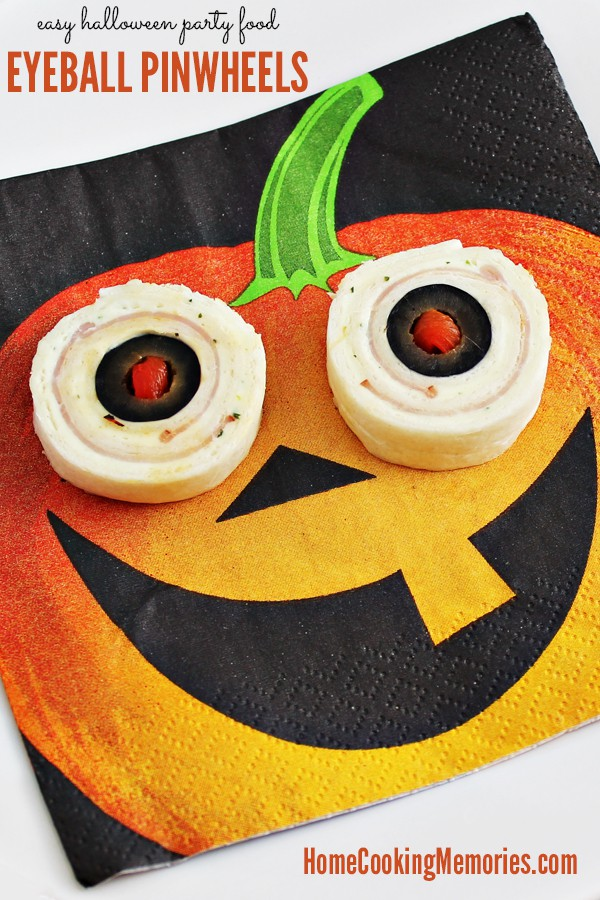 pinwheels on a pumpkin napkin to look like the eyes of a jack-o-lantern