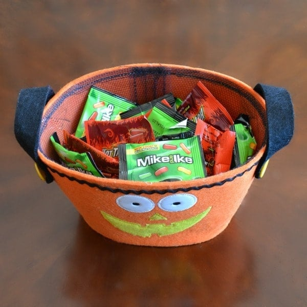 Mike and Ike & Hot Tamales in a jack-o-lantern basket