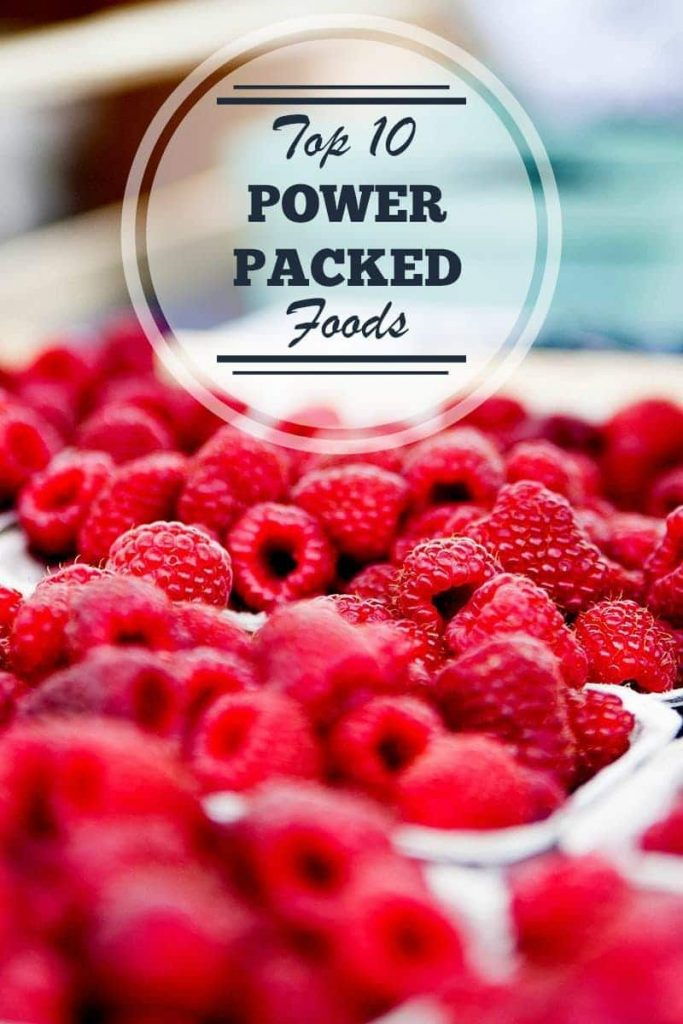 a lot of raspberries with title text reading Top 10 Power Packed Foods