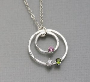a necklace with birthstones on it