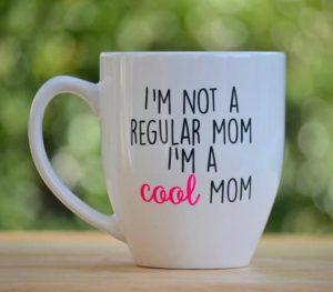 a white mug with text reading I'm not a regular mom I'm a cool mom