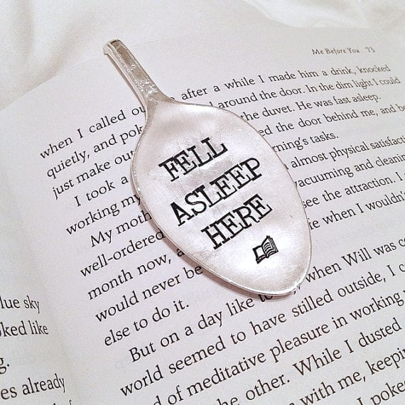 spoon bookmark with text engraved in it reading fell asleep here