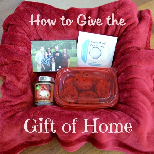 a candle, cookies, cd and picture on a red blanket with title text reading How to Give the Gift of Home