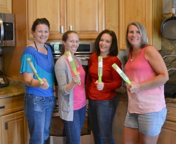 four friends holding KitchenIQ Party Favors, a zester