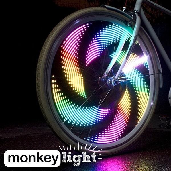 colorful led monkey light on a bike wheel