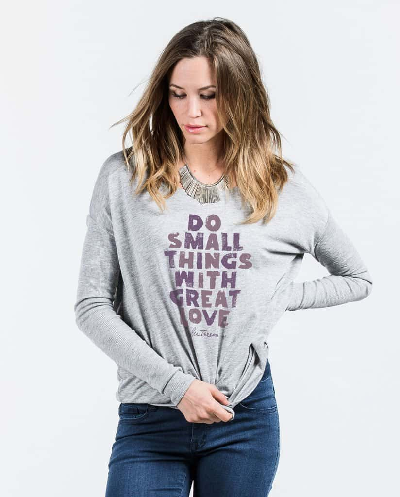 a lady wearing a long sleeve shirt with text reading Do Small Things With Great Love