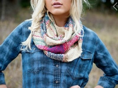 Woman styling multicolored plaid scarf