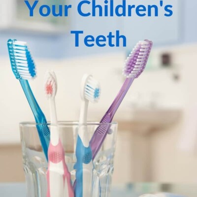 4 toothbrushes in glass cup