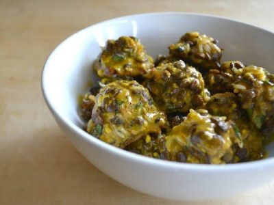 Tangy Vegan Meatballs covered in mustard sauce in white bowl