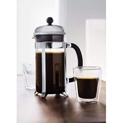 French press full of coffee and glass cup full of coffee