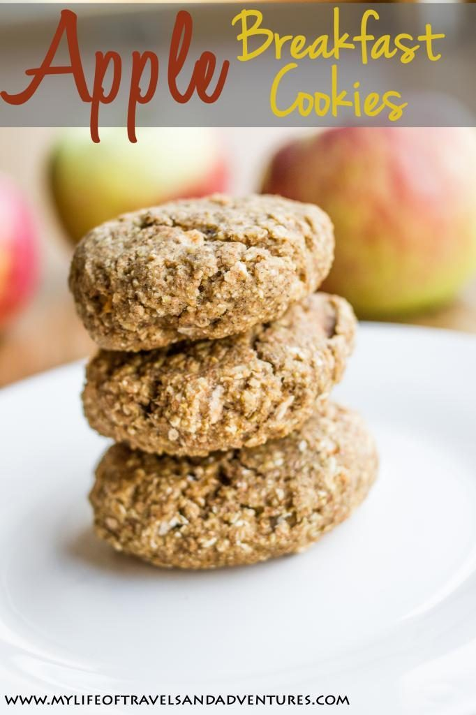 a stack of apple breakfast cookies on a white plate with apples in the background