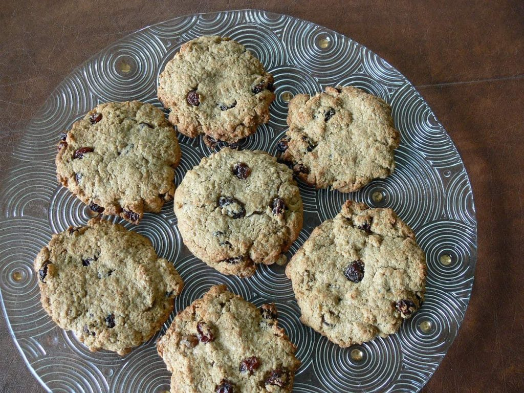 oatmeal banana breakfast cookies on a clear plate on a brown table