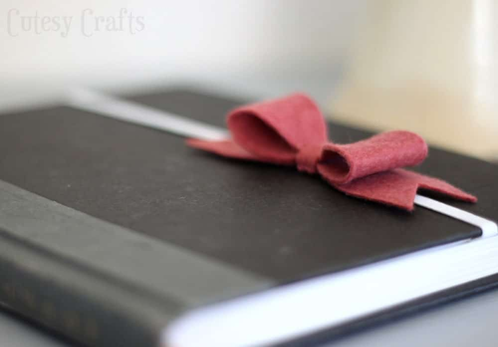 a book with a felt bow bookmark on it