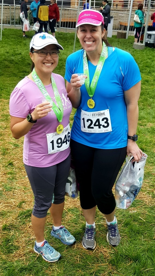 two ladies wearing their medals after the race