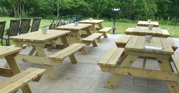 Picnic tables are an inexpensive way to provide seating for lots of guests at outdoor parties