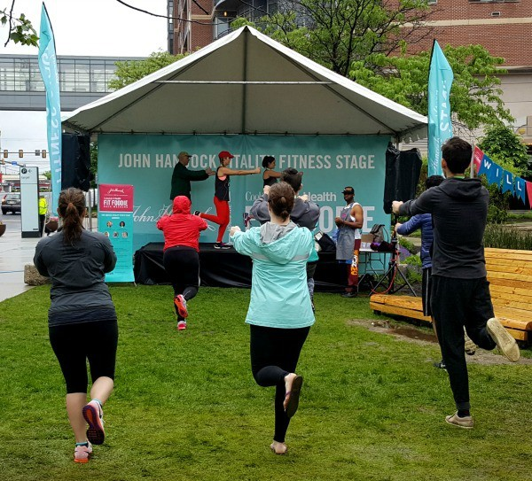 runners doing yoga after the race