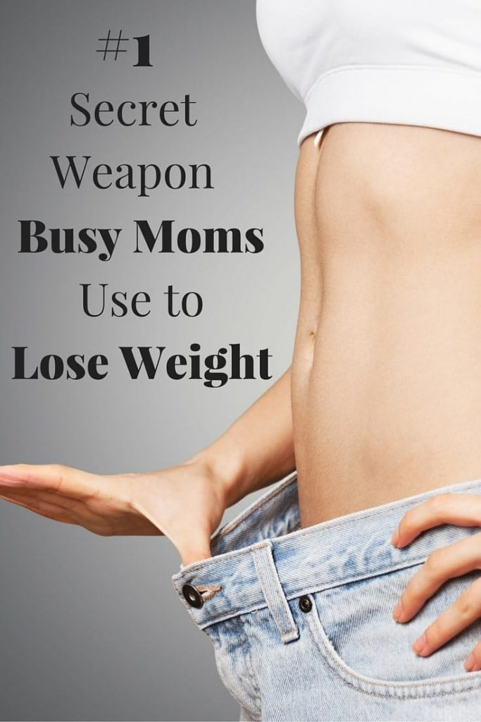 a lady holding her jeans out from her waist to show her weight loss with title text reading #1 Secret Weapon Busy Moms Use to Lose Weight