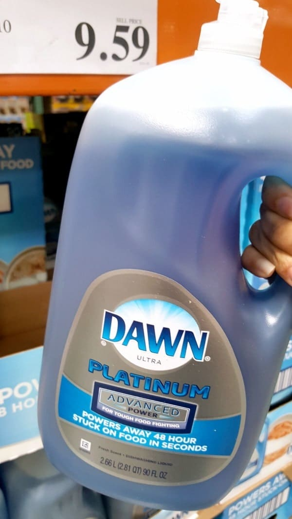 a person holding a bottle of Dawn Ultra Platinum Advanced at Costco