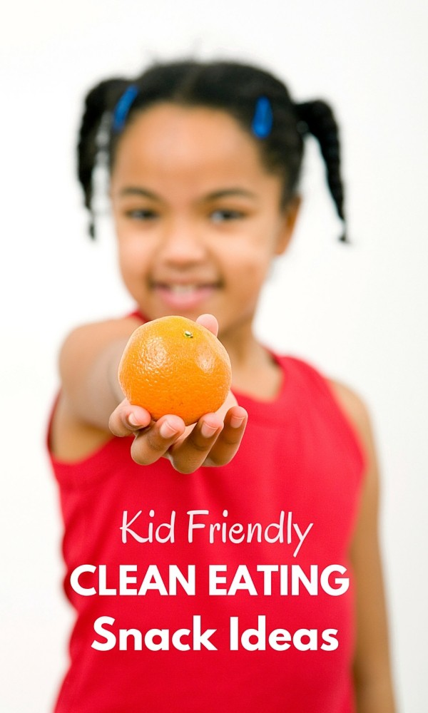 a girl holding an orange with title text reading Kid Friendly Clean Eating Snack Ideas
