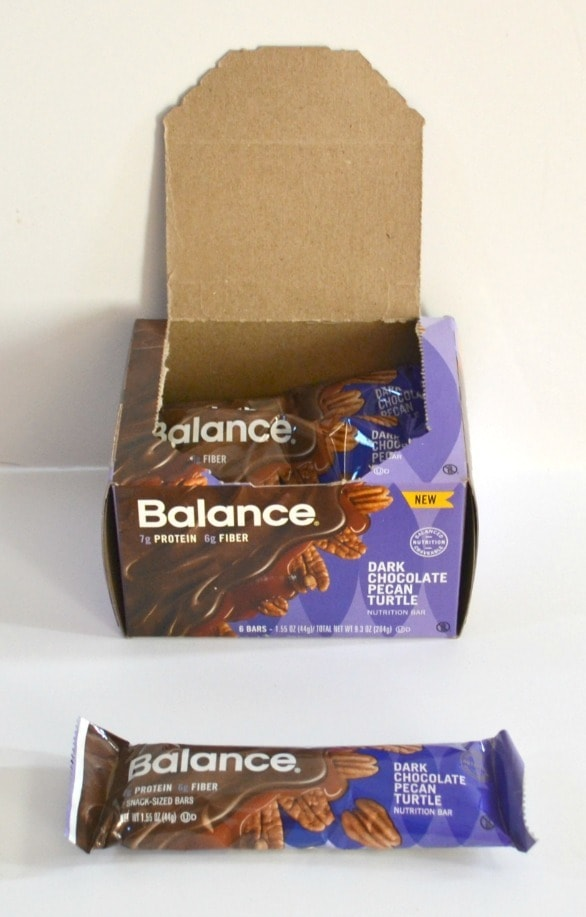 dark chocolate pecan turtle Balance bars in a box and on a white table
