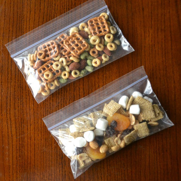 homemade trail mix in two plastic bags on a brown table