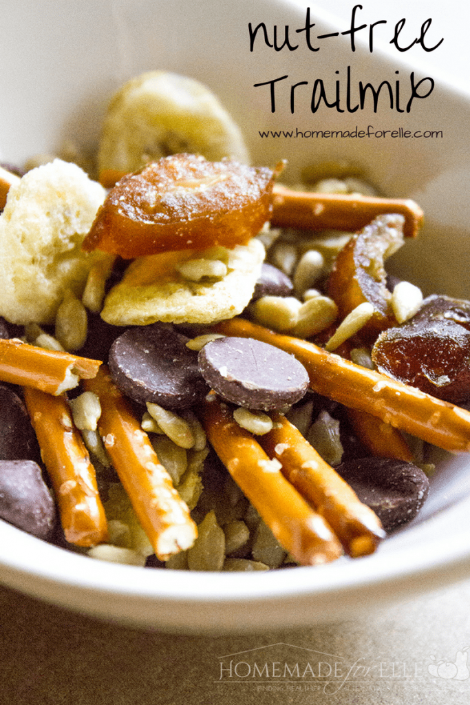 a close up of trail mix in a white dish with title text reading nut-free trail mix