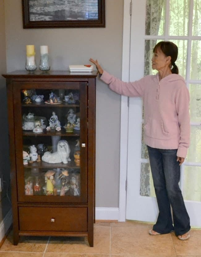 bay-alarm-medical-set-up on a cabinet with a mom ready to push it