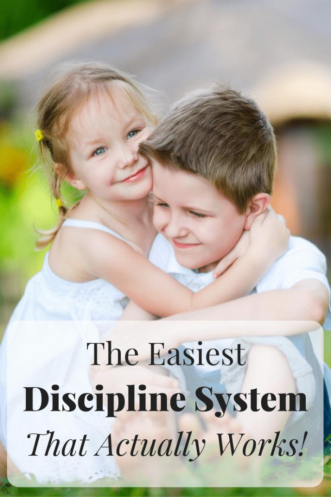 a girl hugging her brother outside on the grass with title text reading The Easiest Discipline System for Kids That Actually Works