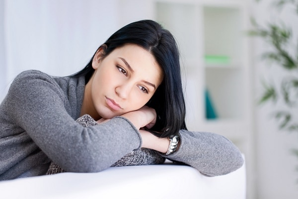 Lonely sad woman deep in thoughts