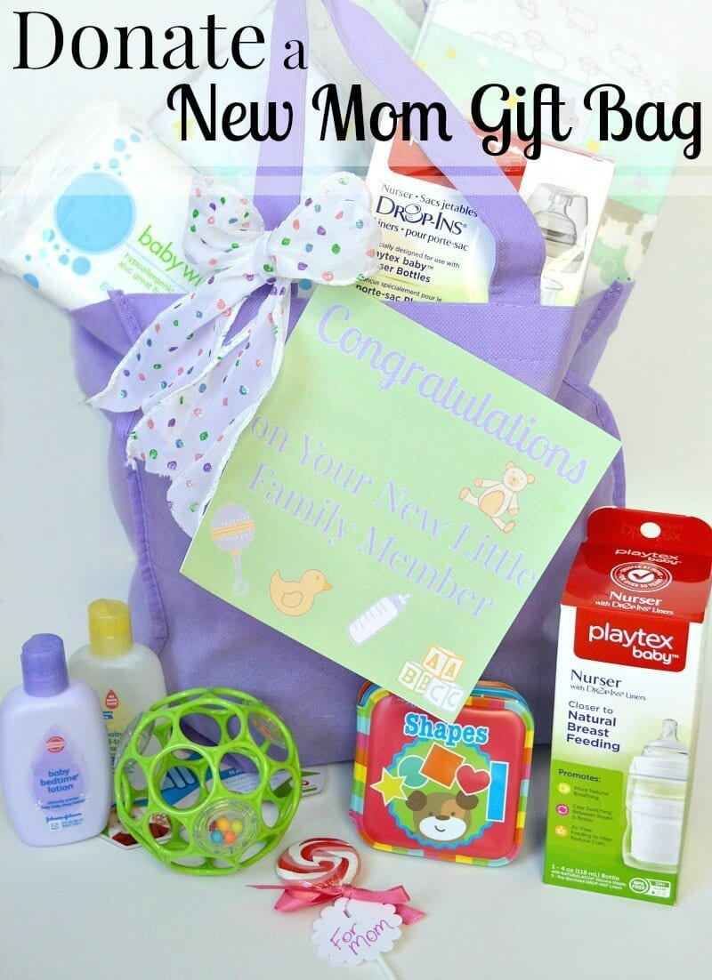 a purple gift bag with lots of baby things in it and in front of it with title text reading Donate a New Mom Gift Bag