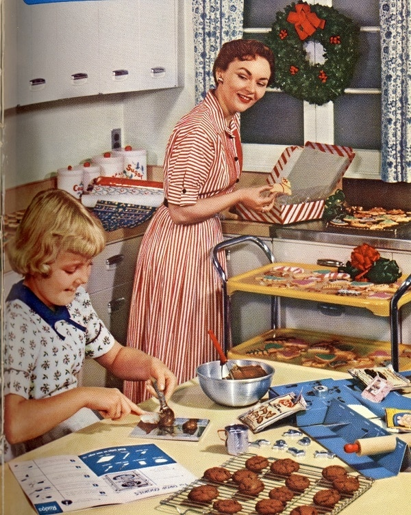 old fashioned image of a mother and daughter baking Christmas cookies together