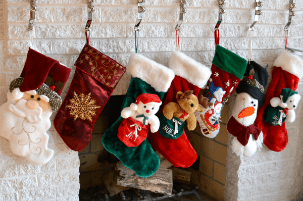 stockings handing from a white brick fireplace