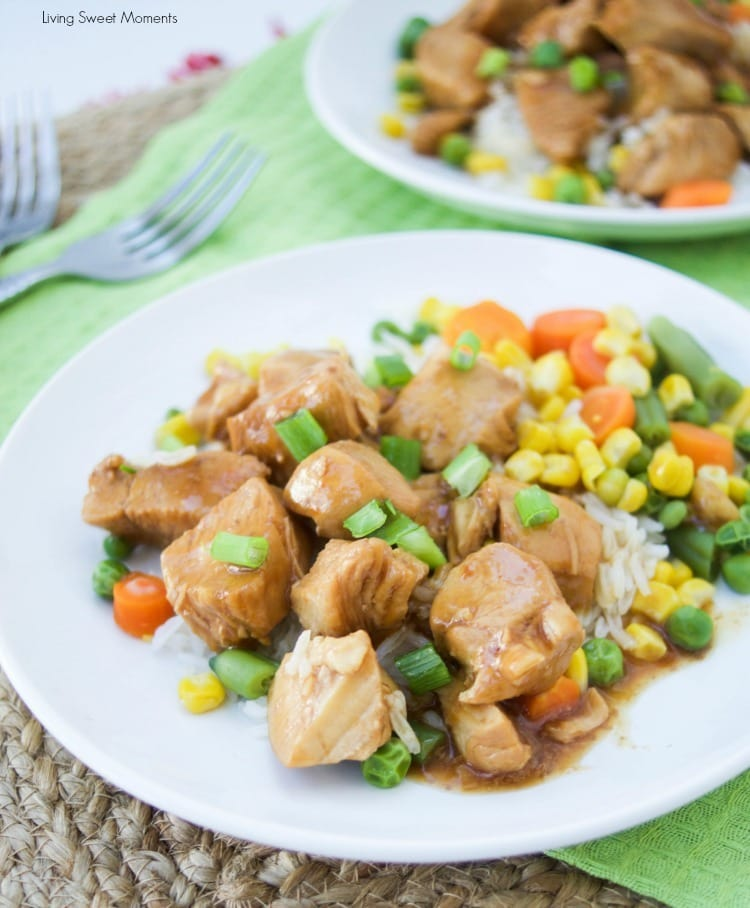 instant pot orange chicken on two plates on a green cloth next to two forks