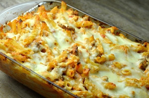 lasagna casserole in a glass baking dish on a brown table