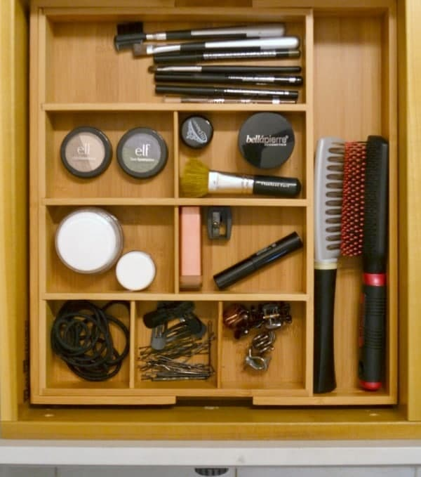 an organized makeup drawer in a bathroom