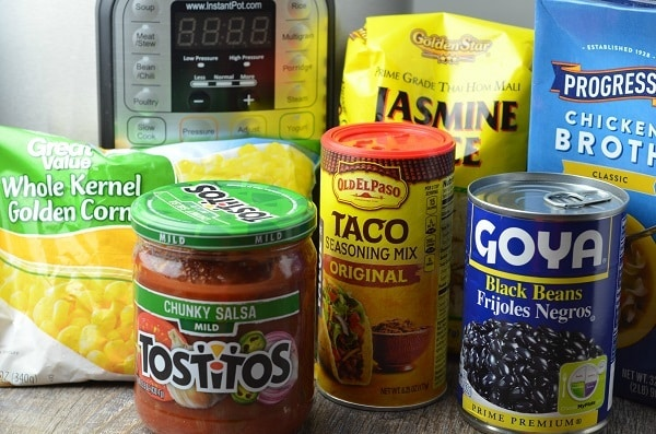 Instant Pot Chicken Taco Bowl Ingredients, frozen corn, salsa, taco seasoning, black beans, chicken broth, jasmine rice, and an instant pot