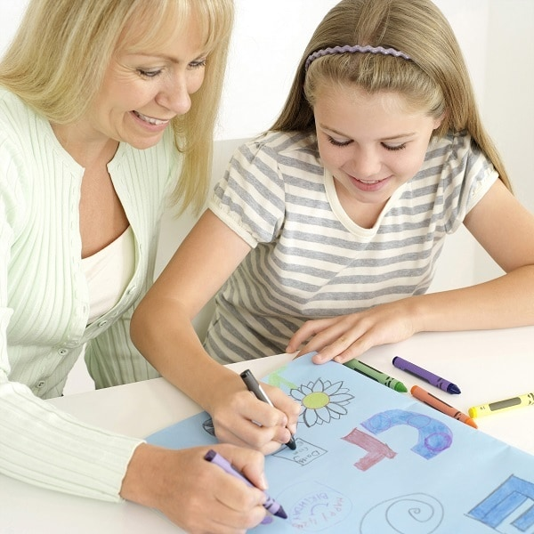 a mother and daughter using crayons