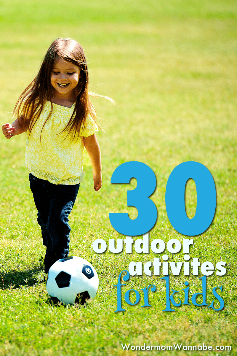 a girl kicking a soccer ball on the grass with title text reading 30 outdoor activities for kids
