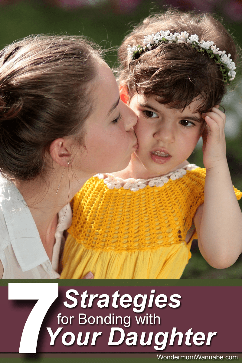 a mother kissing her daughter on the cheek with title text reading 7 Strategies for Bonding with Your Daughter