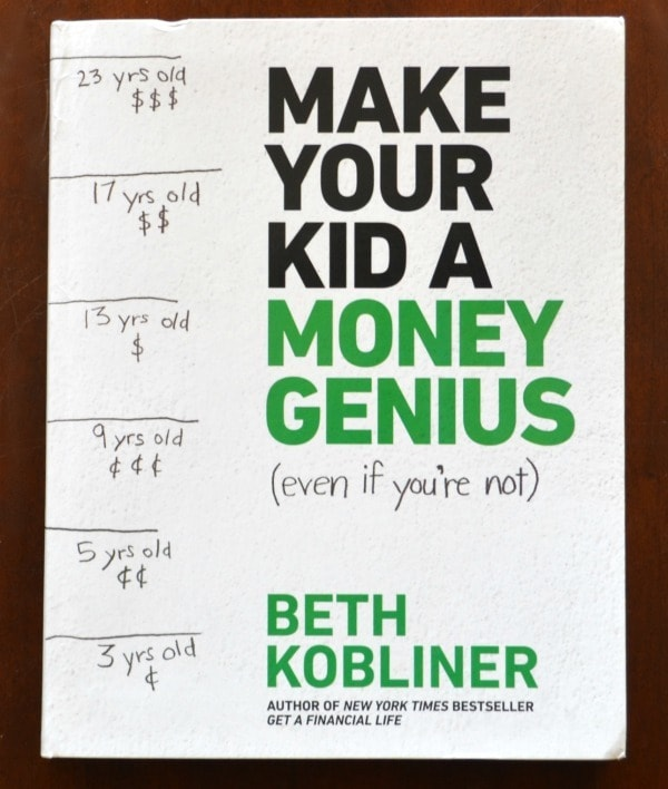 Make Your Kid a Money Genius (Even if You're Not) book on a brown table