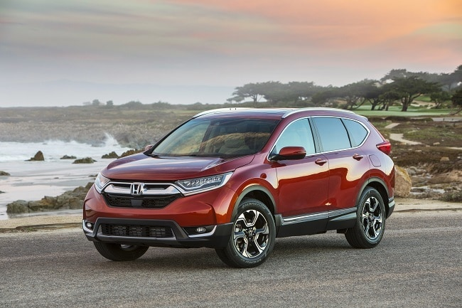 red 2017 Honda CR-V with the ocean in the background